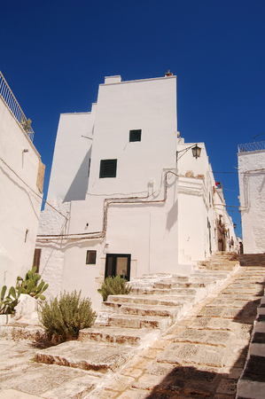 unique characteristics: Glimpse of Ostuni The White City of the Murgia - Apulia - Italy Stock Photo