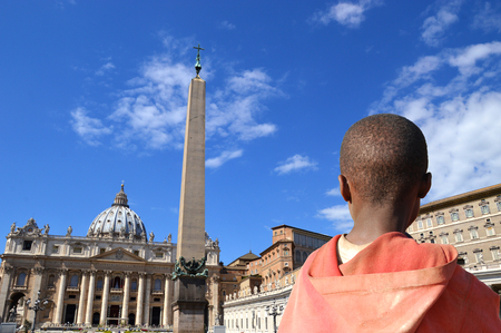 marginalization: an immigrant child who looks at the Vatican