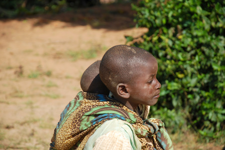 August 8, 2015, Pomerini-Tanzania-Africa-Two unidentified African children, normally are older children to look smaller ones neglected by parents often sick or dead of AIDS or tuberculosis