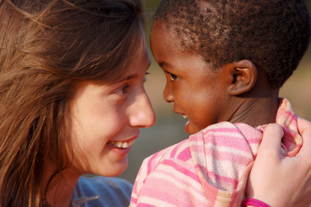 March 28, 2016-Center Smile to Africa in the Village Pomerini in Tanzania-Africa-An unidentified volunteer doctor embraces an unidentified African child, a little patients sick of AIDS, in a gesture of affection that expresses happiness for the success  Editorial