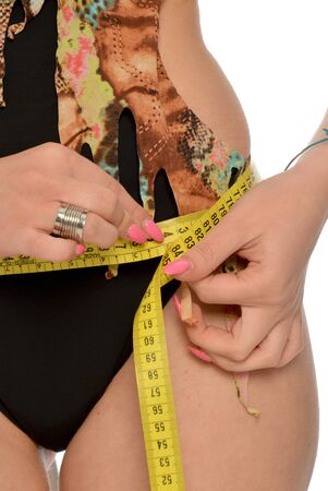 exertion: A woman measuring her waist