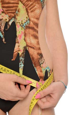 woman measuring: A woman measuring her waist