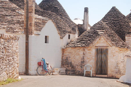 characteristic: A characteristic street of Alberobello with its famous Trulli in Apulia - Italy