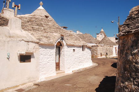 unique characteristics: A characteristic street of Alberobello with its famous Trulli in Apulia - Italy