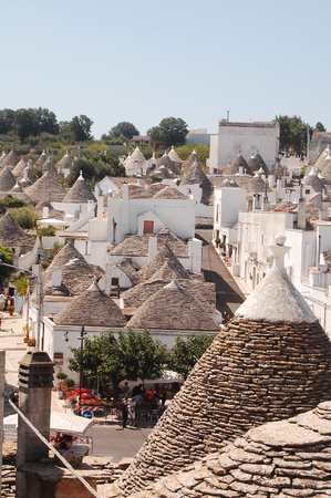 unique characteristics: A view of the town of Alberobello with its famous Trulli in Apulia - Italy Stock Photo