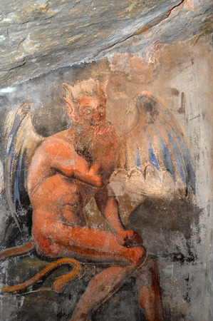 temptations: July 17, 2016-Benedictine Monastery of Subiaco in the Lazio-Italy-Fresco from author unidentified depicting the cave in the monastery where St. Benedict met the devil and his temptations. Editorial