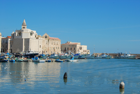 Boats and fishing boats moored in the Port of Trani in Apulia - Italy Stock Photo