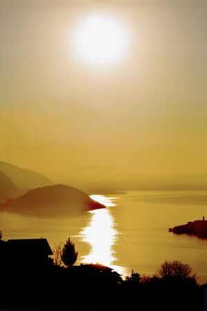 evocative: An suggestive view of Lake Iseo at sunset with the fog - Lombardy - Italy