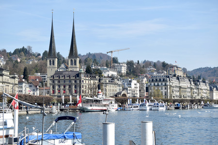 flocking: 30 March, 2017-Lucerne-Switzerland-Panoramic view of the city of Lucerne and its lake, a destination for tourists flocking to its shores and its boats. At the center the cathedral and its towers. Editorial