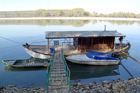 A traditional fishing boat moored on the river Po - Italy Stock Photo