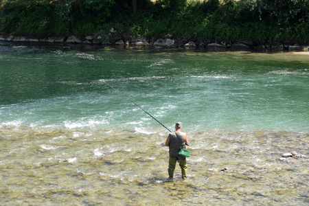 Fisherman in a mountain river of Upper Lombardy - Italy Imagens