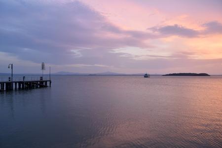 Italian Lakes - Evening navigation on the beautiful Lake Trasimeno at sunset - Umbria - Italy 版權商用圖片