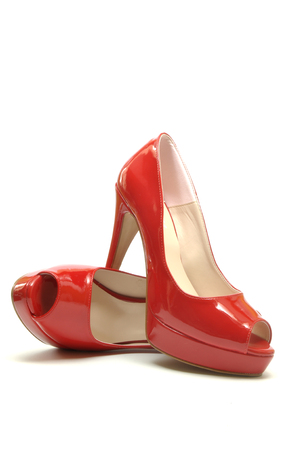 A pair of elegant red shoes for the year-end party Foto de archivo