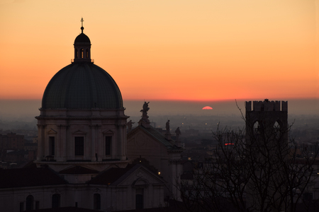 The dome of Brescia Cathedral in backlight at sunset - Brescia - Lombardy - Italy