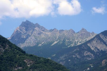 View on the mountain ranges of the Aosta Vallei Alps in Italy Stock Photo - 128000206