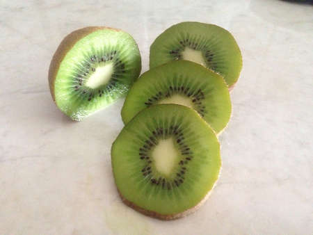 Sliced juicy kiwi  Фото со стока