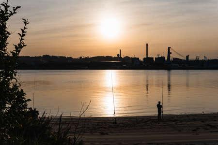 scenery of a sunset in the harbor Foto de archivo
