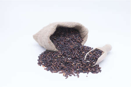 gunny bag: Rice berry grains in gunny bag Stock Photo
