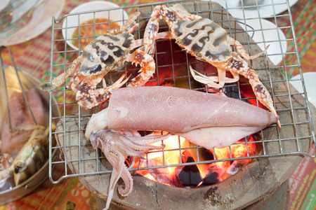 Close up fresh squid and horse crab  barbeque grilled on charcoal stove