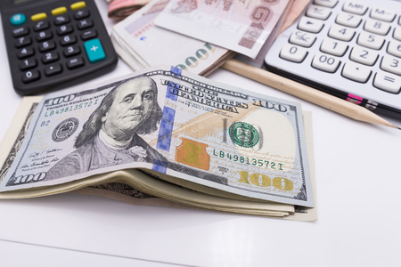 capital gains: bunch of the  one hundred dollar bills and wallet