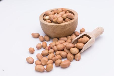 earthnuts: Peanut in Gunny Bag on white background