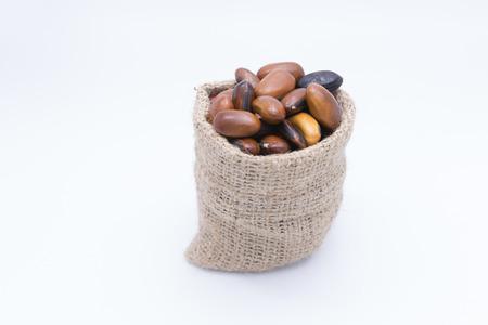 gunny bag: Red kidney beans in gunny bag isolate on white background