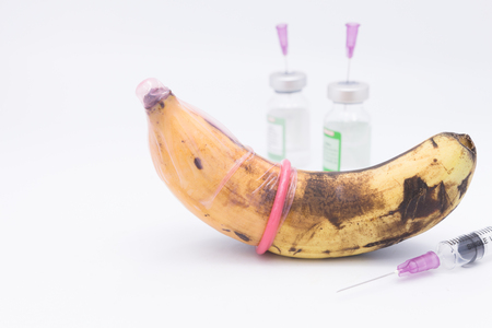transmitted: rotten banana in condom,sexually transmitted disease concept
