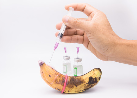 sexually transmitted disease: rotten banana in condom with hand injection,sexually transmitted disease concept