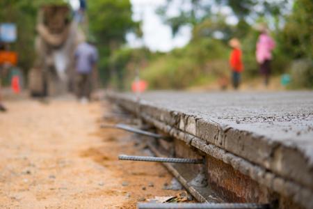 Spreading concrete for road concrete   repair Stock Photo