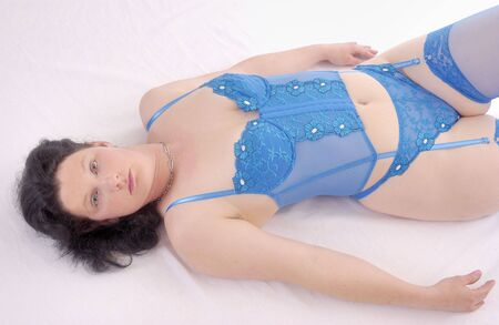 blue lingerie: young woman is posing in sexy blue lingerie in Studio