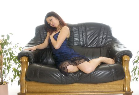 asien: Asien woman in blue skirt on sofa Stock Photo