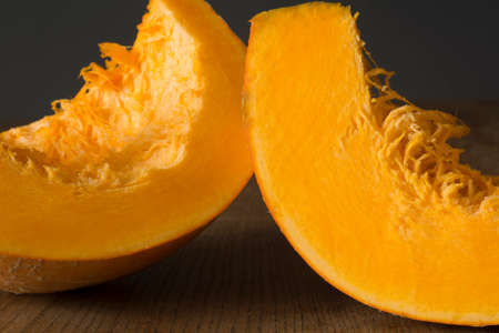 backgruond: Pumpkin slices on wooden table and gray backgruond Stock Photo