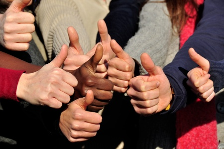 team building: Hands of young people