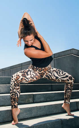 street dance: Young Woman Practicing Contemporary Dance Excercise on Stairs