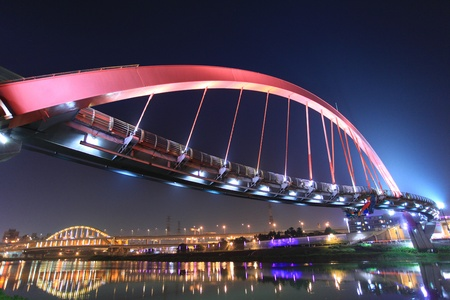 rainbow bridge: Pleasing reflection of the rainbow bridge at night