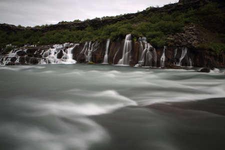 Hraunfossar waterfall (Western Iceland) Hraunfossar waterfall's water is falling into Hvita river Iceland