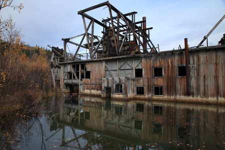 The remains of delelict mining dredge outside of Dawson City,