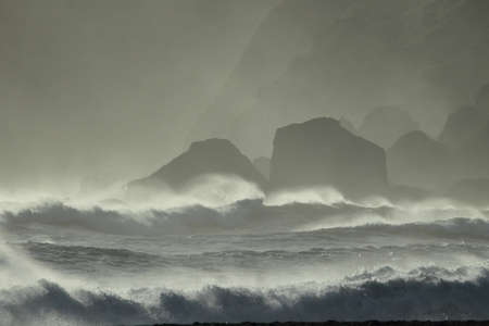 Reynisdrangar Sea Stacks, Icelandwaves breaking on Renisfjara beach in front of the Reynisdrangar basalt sea stacks, southern Iceland Reklamní fotografie
