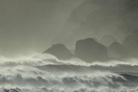 Reynisdrangar Sea Stacks, Iceland waves breaking on Renisfjara beach in front of the Reynisdrangar basalt sea stacks, southern Iceland Reklamní fotografie