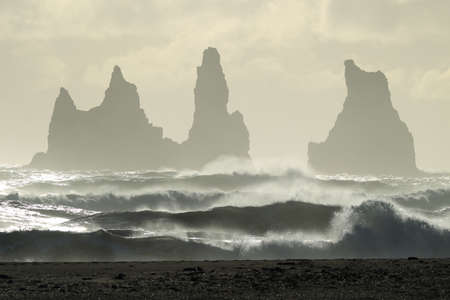 Reynisdrangar Sea Stacks, Icelandwaves breaking on Renisfjara beach in front of the Reynisdrangar basalt sea stacks, southern Iceland Stok Fotoğraf