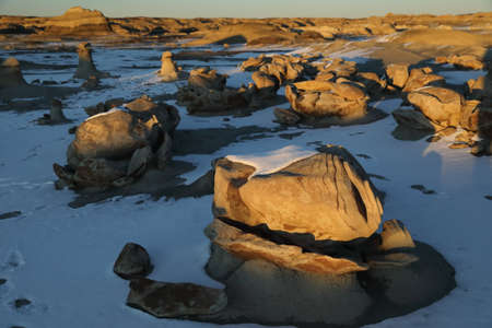 Striped rock eggs with sandstone at dawn, Bisti Badlands, De-Nah-Zin Wilderness Area, New Mexico, USA Stock Photo