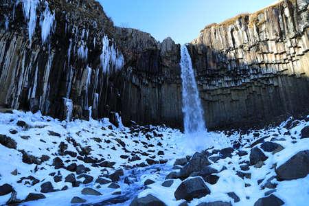 Svartifoss Waterfall in Winter , Skaftafell, Vatnajoekull National Park, Iceland Stock fotó