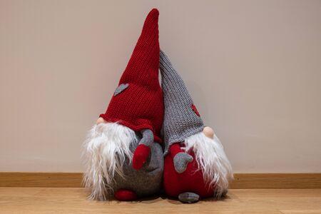 Christmas-dwarfs with a simple background Archivio Fotografico - 137255339
