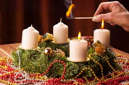 Advent+Adventskranz, Die dritte Advents Kerze wird angezündet.