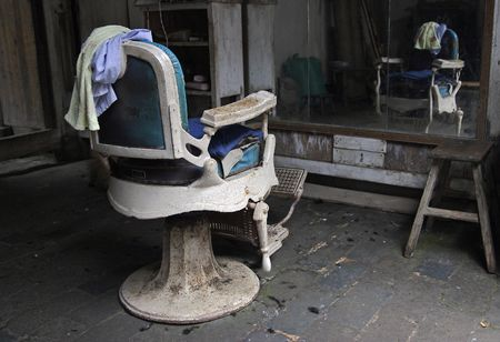 Old barber chair in Chengkan village, China Stock Photo