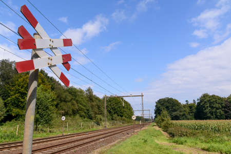 Sign by a railway crossing in holland photo