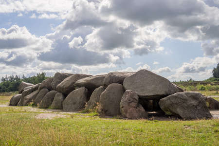 prehistorical: Sunny HDR of megalithic stones in Drenthe, Netherlands, with a dramatic sky above Stock Photo