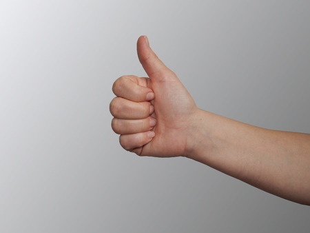 Thumb up  in neutral background  photo