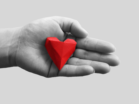 Open hands and red heart. The concept of love or health insurance Stockfoto