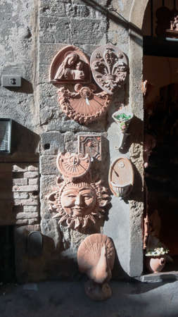 Sun watches made of terracotta, Volterra, Italy Stock Photo